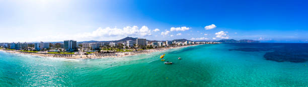 Spain, Balearic Islands,CalaBona, Aerial panorama of coastline of resort town in summer