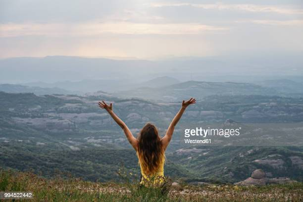spain, barcelona, back view of happy young woman on montcau mountain - gratitude stock pictures, royalty-free photos & images
