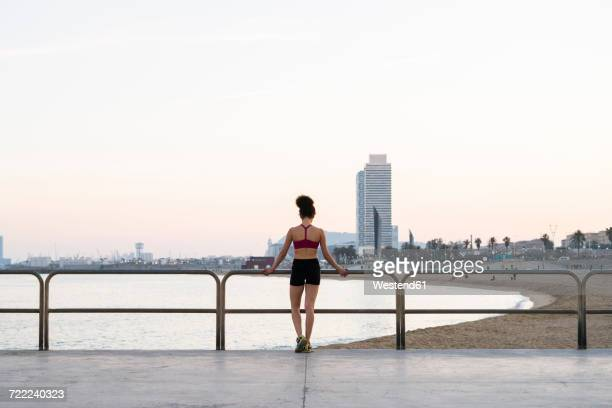 Spain, Barcelona, back view of young jogger
