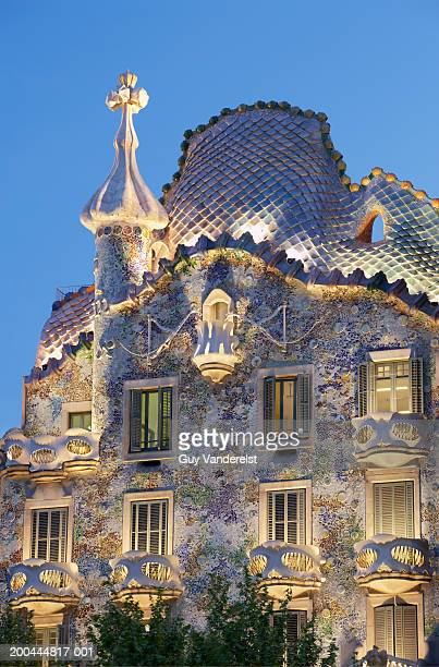 Spain, Barcelona, Casa Batllo illuminated at dusk