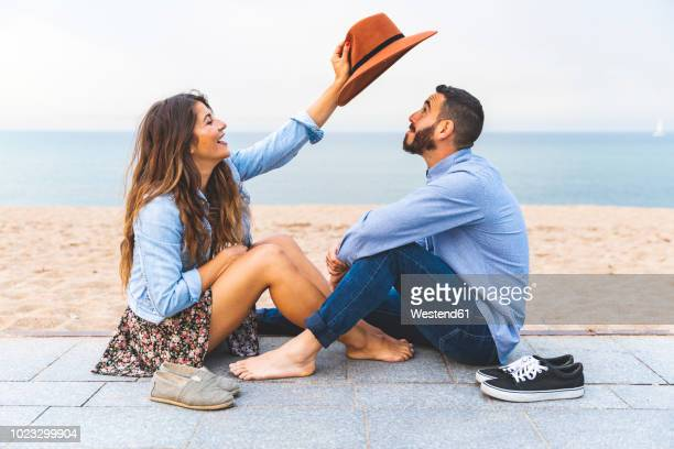 spain, barcelona, couple having fun together on the beach - southern europe stock pictures, royalty-free photos & images