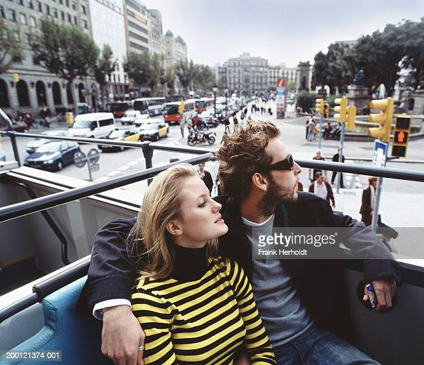 spain, barcelona, couple in open top bus - double decker bus stock pictures, royalty-free photos & images