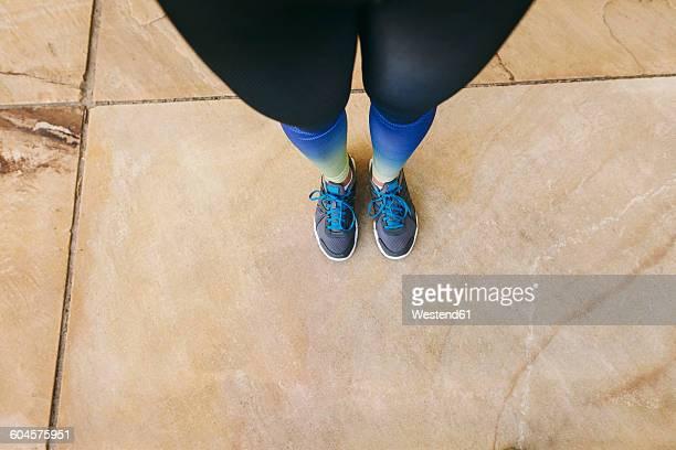 Spain, Barcelona, female jogging standing