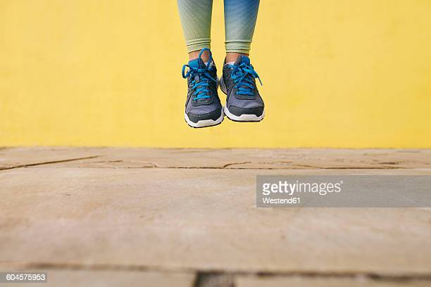 Spain, Barcelona, jogging woman, jumping, running shoes