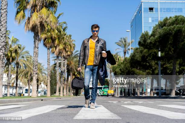 spain, barcelona, man in the city walking on the street - approaching stock pictures, royalty-free photos & images