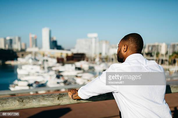 Spain, Barcelona, man looking at view