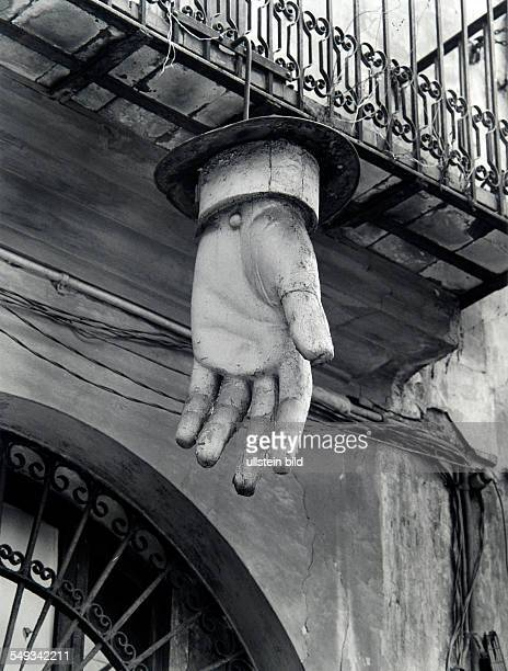 Spain Barcelona oversized hand made of plastic hanging on front of old building for advertising