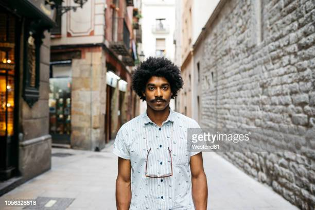spain, barcelona, portrait of man with moustache and curly hair - big hair stock photos and pictures