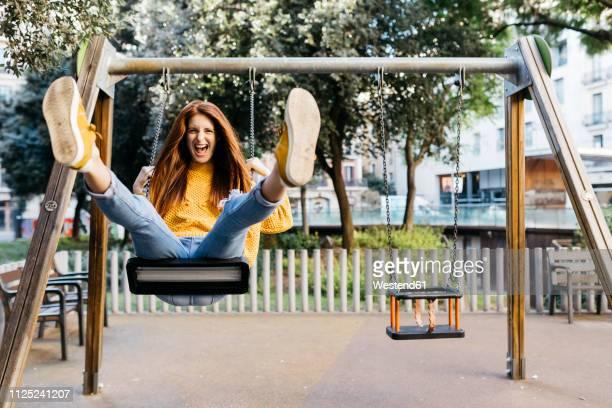 spain, barcelona, red-haired girl playing the guitar in the city - swinging stock pictures, royalty-free photos & images