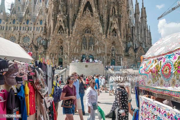 Spain, Barcelona, Sagrada Familia, Antoni Gaudi, Art Nouveau architecture, tourist crowds and vendor booths.