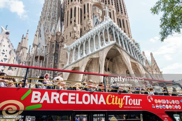 Spain, Barcelona, Sagrada Familia, Antoni Gaudi, double decker sightseeing tour bus.