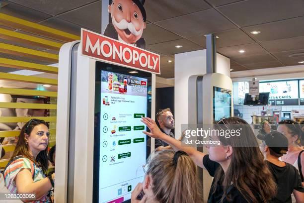 Spain, Barcelona, Sagrada Familia, McDonalds, fast food, self-serve touch screen ordering kiosk.