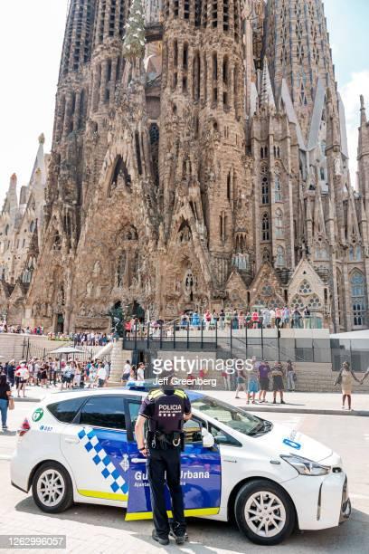 Spain, Barcelona, Sagrada Familia, police car and patrol for public safety.