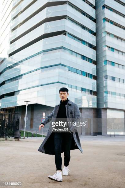 spain, barcelona, stylish young man posing on the street - menswear stock pictures, royalty-free photos & images