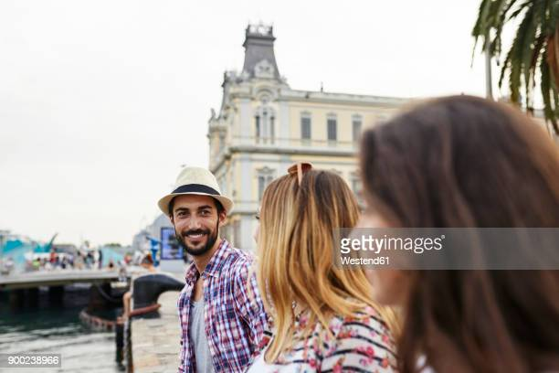 Spain, Barcelona, three tourists at a pier in the city