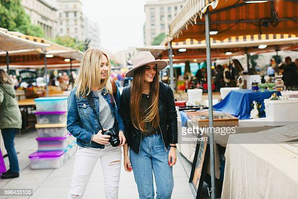 spain, barcelona, two young women on flea market - flea market stock pictures, royalty-free photos & images