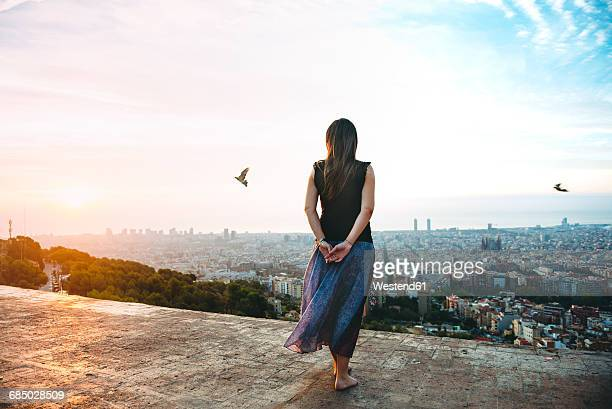 spain, barcelona, woman looking at view over city - observation point stock pictures, royalty-free photos & images