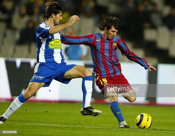 Barcelona's Argentinian golden boy Messi vies with Espanyol's Jarque during their Spanish League football match at the Olympic Stadium in Barcelona...