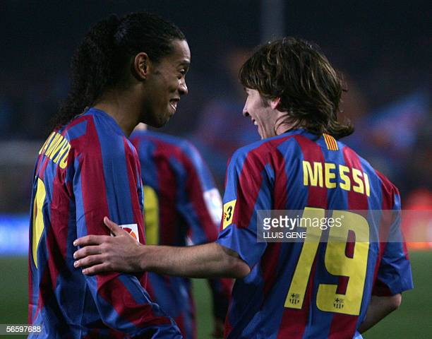 Barcelona's Argentinian Leo Messi celebrates with Ronaldinho after scoring against Real Athletic during their Spanish League football match at the...