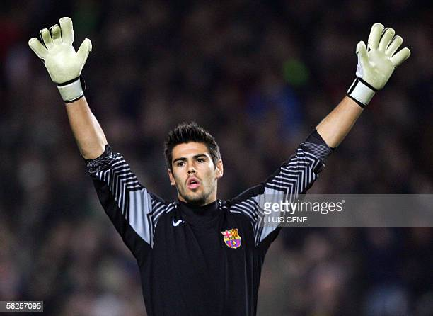 Barcelona's goalkeeper Victor Valdes celebrates after Henrik Larsson scored to make it 3-1 against Werder Bremen during their Champions League group...