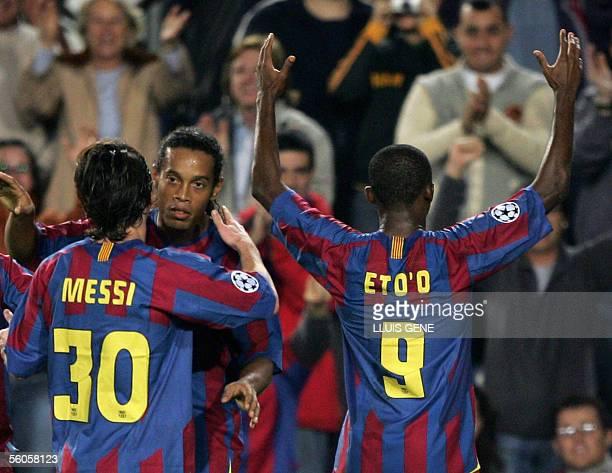 Barcelona's Samuel Eto'o celebrates with teamates Brazilian Ronaldinho and Argentinian Leo Messi after scoring to make it 40 against Panathinaikos...