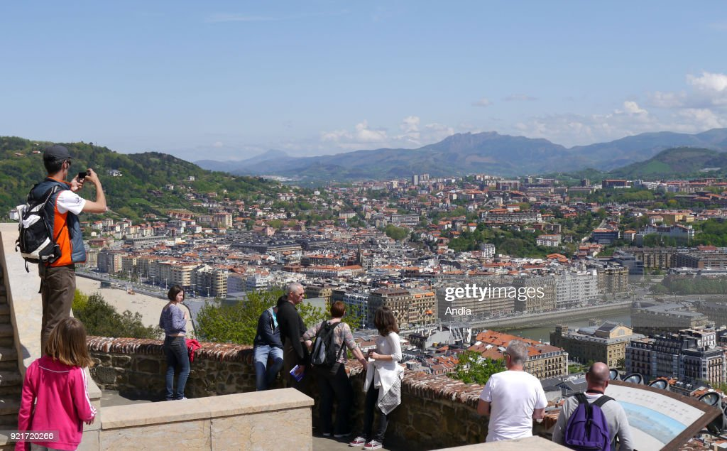 Basque Country; San Sebastian. . Overview of the capital city of Gipuzkoa from the top of Mount Urgull (Monte Urgull) above the Mota Castle overhanging the city and La Concha Bay. The Pyrenees mountain range in the background.