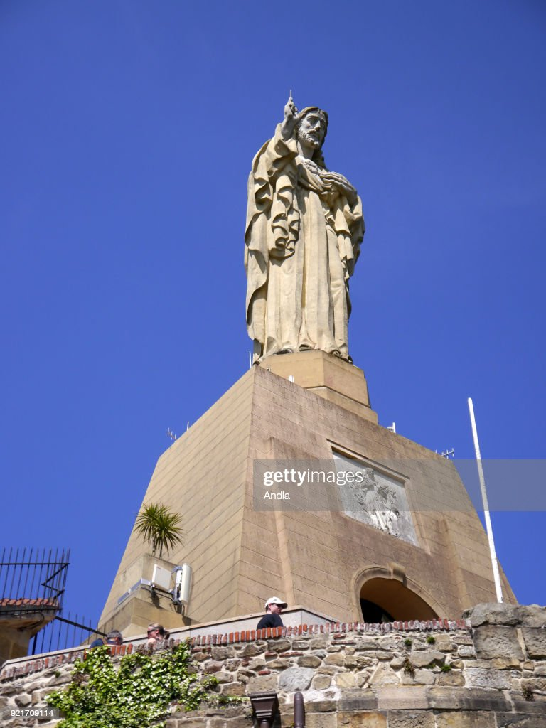 Basque Country; San Sebastian. . statue of the Sacred Heart (Sagrado Corazon) on the top of Mount Urgull (Monte Urgull) above the Mota Castle overhanging the city and La Concha Bay.