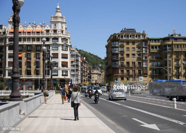 Basque Country San Sebastian traffic and pedestrians crossing the Santa Catalina Bridge in the direction of Gros District and Paseo Ramon Maria Lili