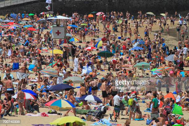 Spain, Basque Country. The crowded beach of San Sebastian. La Concha Bay.