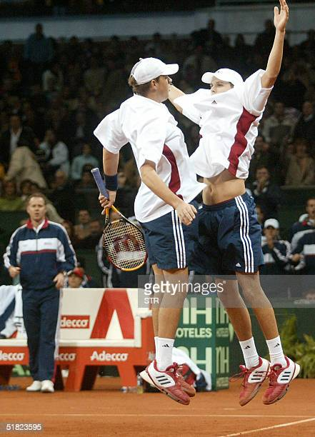 Bob Bryan of the US and his twin Mike celebrate after defeating Former number one Juan Carlos Ferrero and Tommy Robredo of Spain at the end of the...