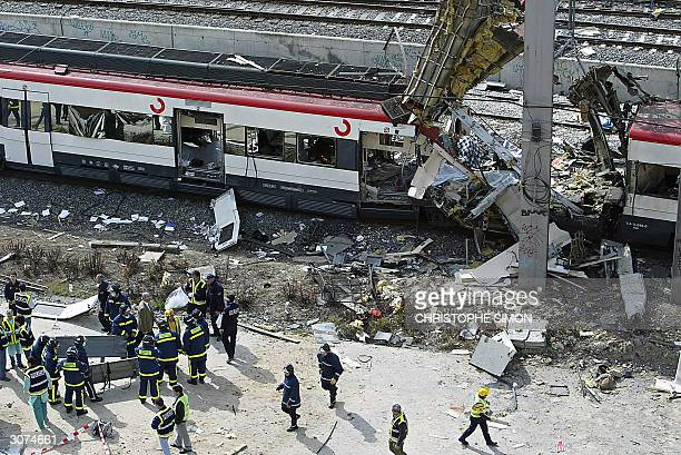 Bodies of victims are evacuated after a train exploded at the Atocha train station in Madrid 11 March 2004 At least 173 people were killed and some...