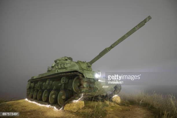 Spain, Burgos, misty night scene of an abandoned Military war tank