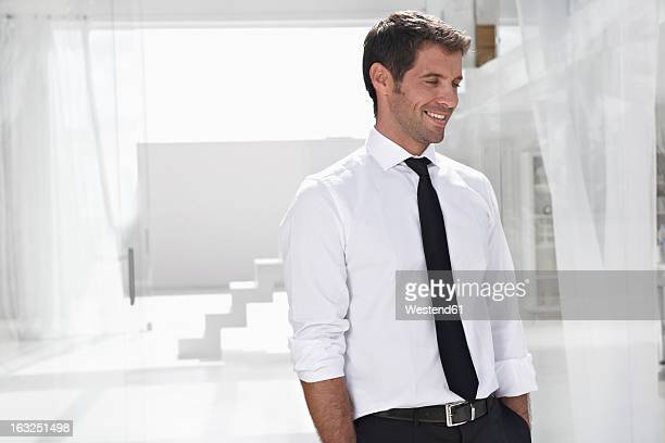 Spain, Businessman looking away, smiling