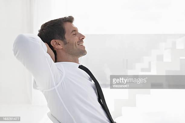 Spain, Businessman relaxing, smiling