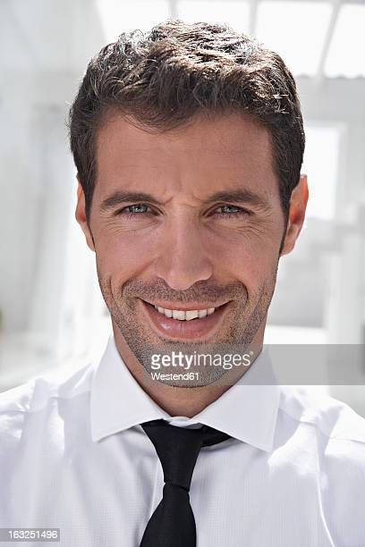 Spain, Businessman smiling, portrait