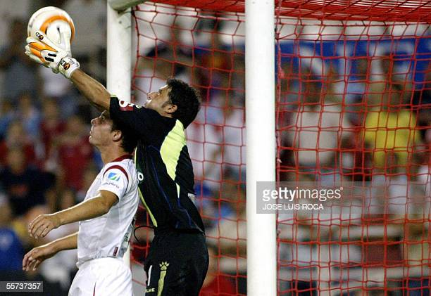 Cadiz's goalie Armando Rivero catches the ball above Sevilla's Kepa during their Spanish league football match at the Sanchez Pizjuan stadium in...