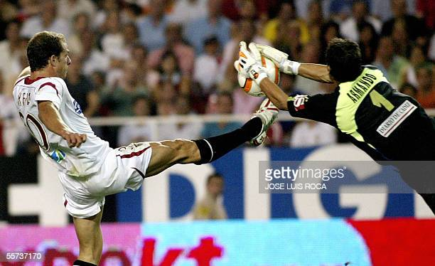 Cadiz's goalkeeper Armando makes a save by Sevilla's Kepa during their Spanish league football match at the Sanchez Pizjuan stadium in Seville 21...