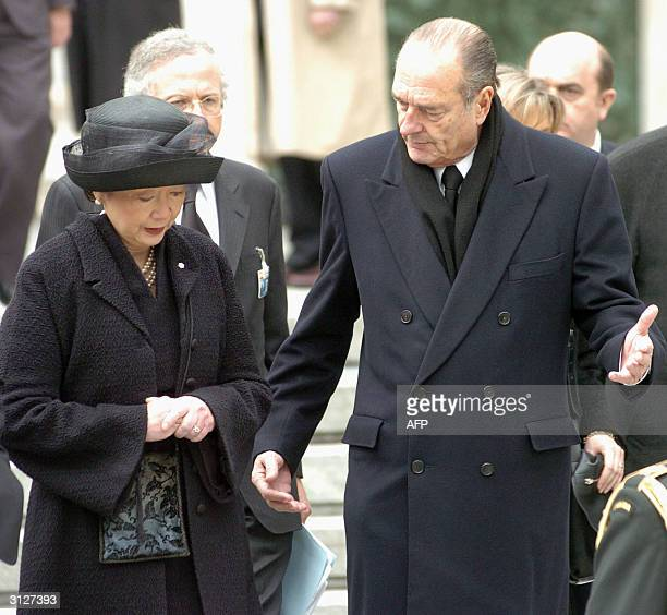 Canada's Governor General Adrienne Clarkson talks to French President Jacques Chirac outside the Almudena Cathedral after the memorial mass for the...