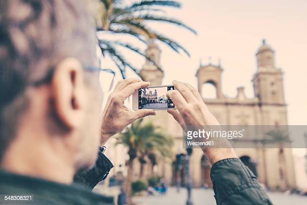 spain, canary islands, gran canaria, las palmas, man taking picture of catedral de santa ana - las palmas cathedral stock pictures, royalty-free photos & images