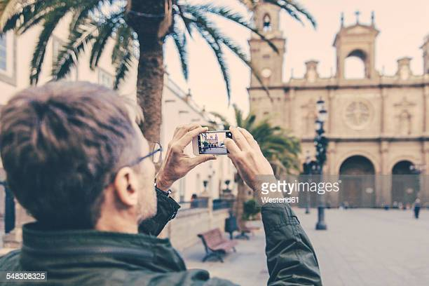 spain, canary islands, gran canaria, las palmas, man taking picture of catedral de santa ana - las palmas cathedral stock photos and pictures