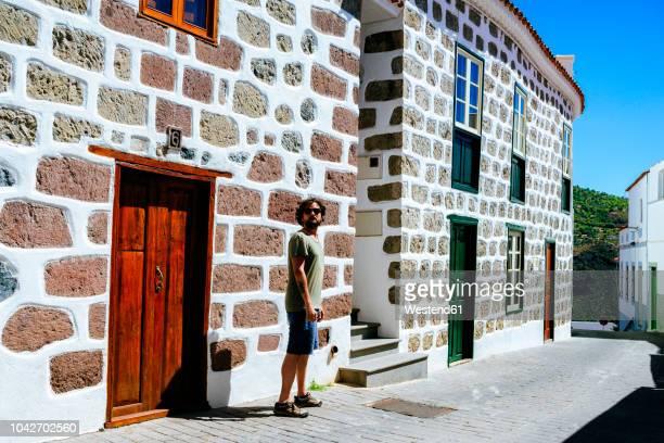 spain, canary islands, gran canaria, man walking through tejeda - tejeda stock pictures, royalty-free photos & images