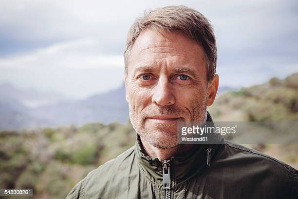 Spain, Canary Islands, Gran Canaria, portrait of mature man in the nature