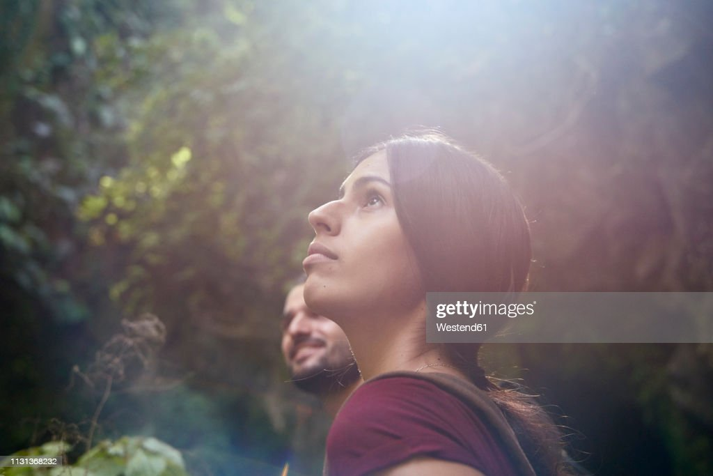 Spain, Canary Islands, La Palma, female hiker with boyfriend in a forest looking up : Stock Photo
