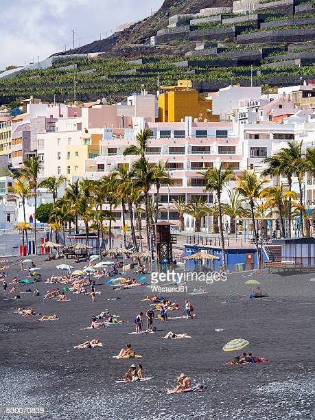 spain, canary islands, la palma, puerto naos, tourists on the black lava beach - arrecife stock photos and pictures