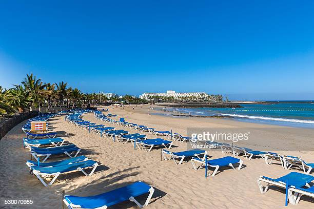 Spain, Canary Islands, Lanzarote, Costa Teguise, Beach Baja de los Charcos, Hotel Las Salinas in the background