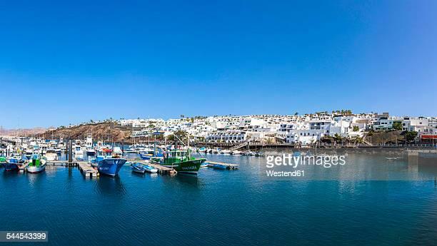 spain, canary islands, lanzarote, fishing harbor and coastal village puerto del carmen - puerto del carmen stock pictures, royalty-free photos & images