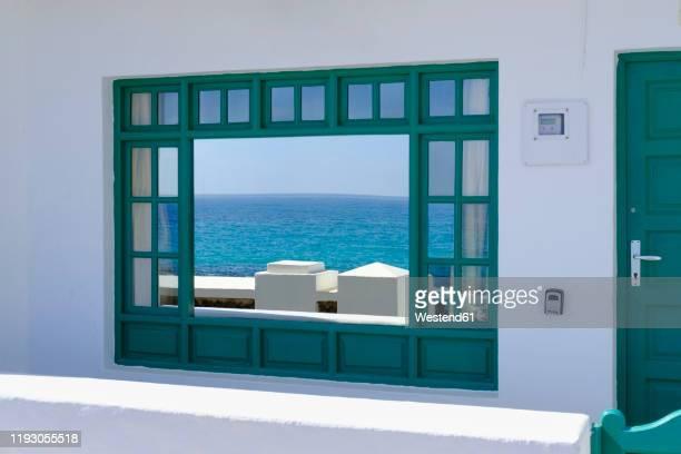 spain, canary islands, punta mujeres, atlantic ocean reflecting in shiny window - mujeres fotos stockfoto's en -beelden