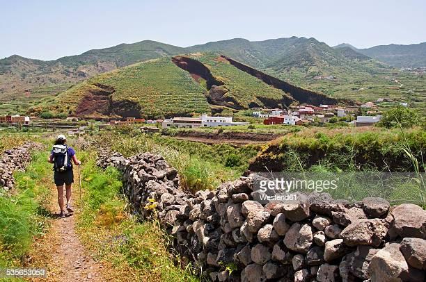 Spain, Canary Islands, Tenerife, El Palmar, female hiker at Teno Mountains