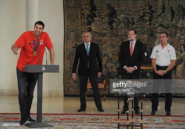 Spain captain Felipe Reyes addresses the media with Spanish Prime Minister Mariano Rajoy and head coach Sergio Scariolo at the Moncloa palace after...