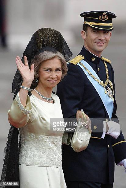 CAPTION ADDITION POOL Spanish Queen Sofia waves to the crowd as she walks with her son Crown Prince Felipe of Bourbon between the Almudena Cathedral...